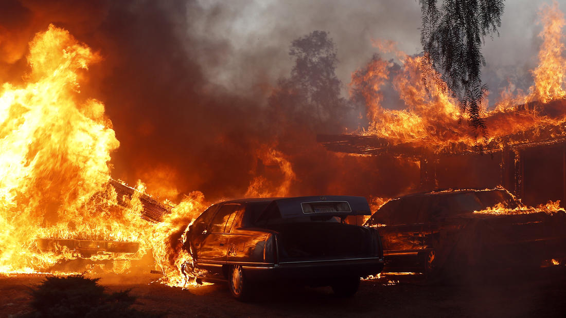 A home and cars in the path of the Creek fire are engulfed in flames. (Luis Sinco / Los Angeles Times)