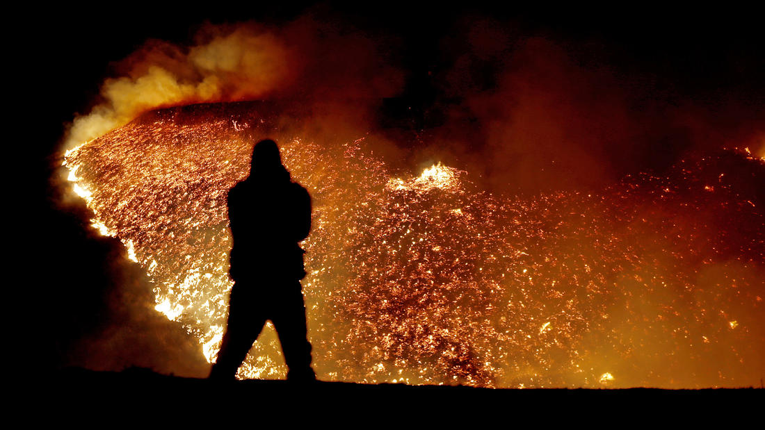 The Creek fire burns into the night in the Shadow Hills. (Luis Sinco / Los Angeles Times)