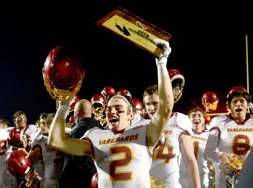 Justin Simpson celebrates after El Modena defeated Don Lugo for the Southern Section Division 7 championship on Dec. 2. (Jennifer Cappuccio Maher)