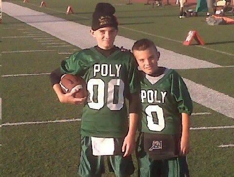 Justin Simpson, right, and brother Aaron were ball boys for Long Beach Poly. (Simpson family photo)