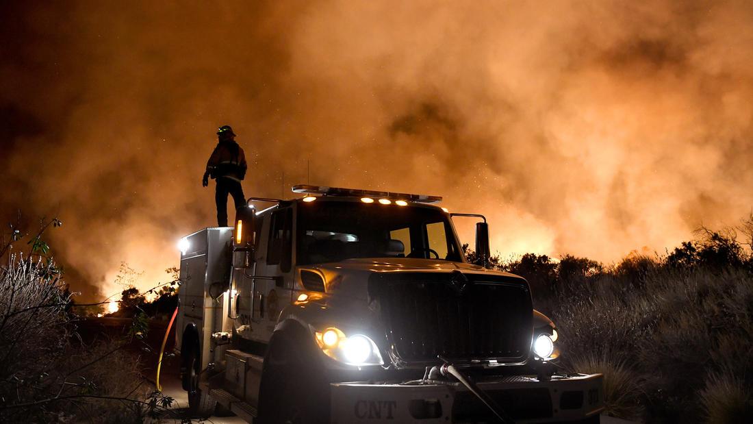 Fire personnel keep an eye on the Thomas fire on Toland Road near Santa Paula. (Michael Owen Baker)