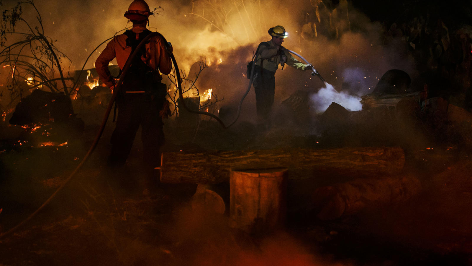 Fire crews hose down hot spots on North Rice Road in Ojai. (Marcus Yam / Los Angeles Times)