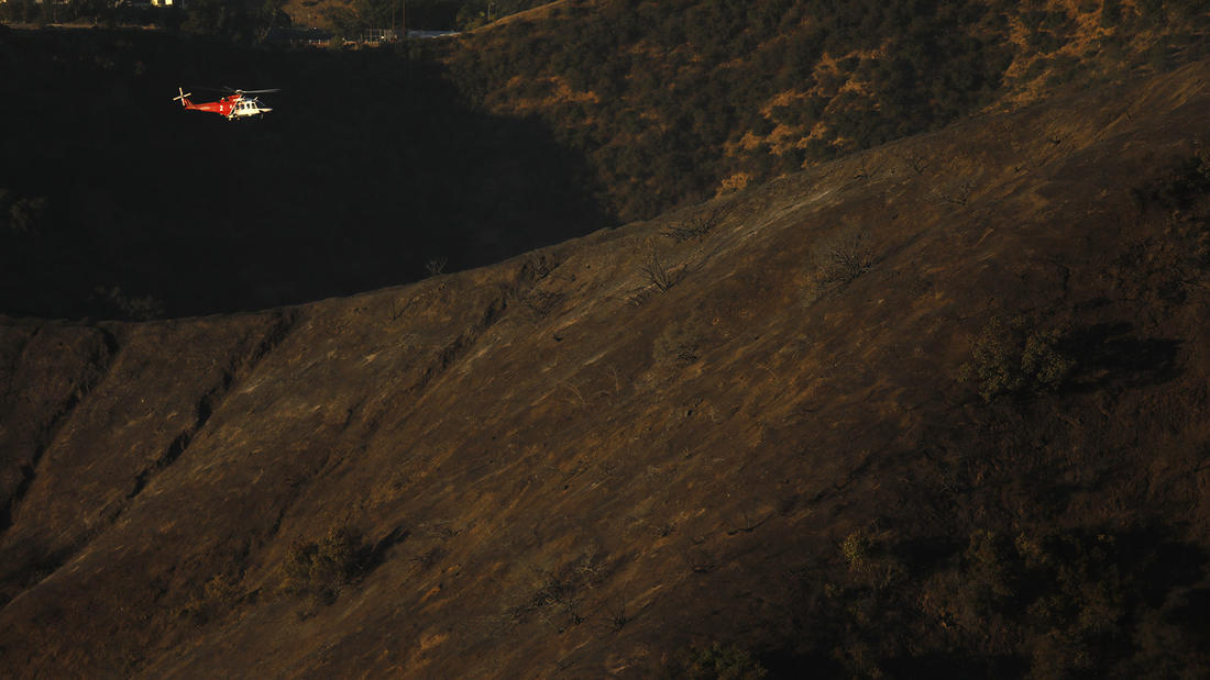 A helicopter scouts for hot spots from the Skirball fire in Bel-Air. (Genaro Molina / Los Angeles Times)