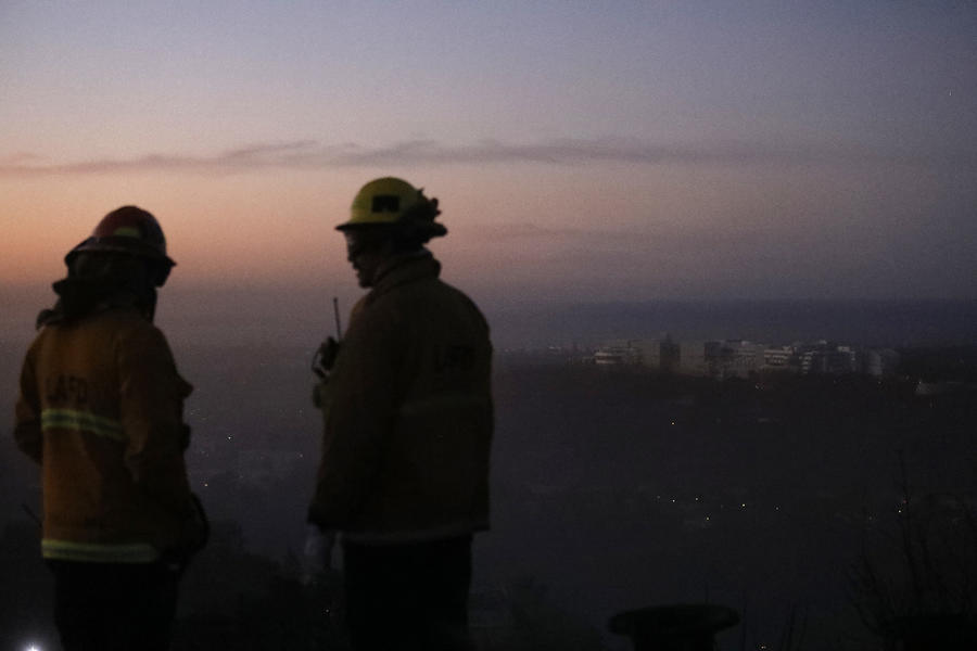 ptain Bob Williams, left, and firefighter Bobby D'Amico look for hot spots from the Skirball fire Thursday morning. (Genaro Molina / Los Angeles Times)
