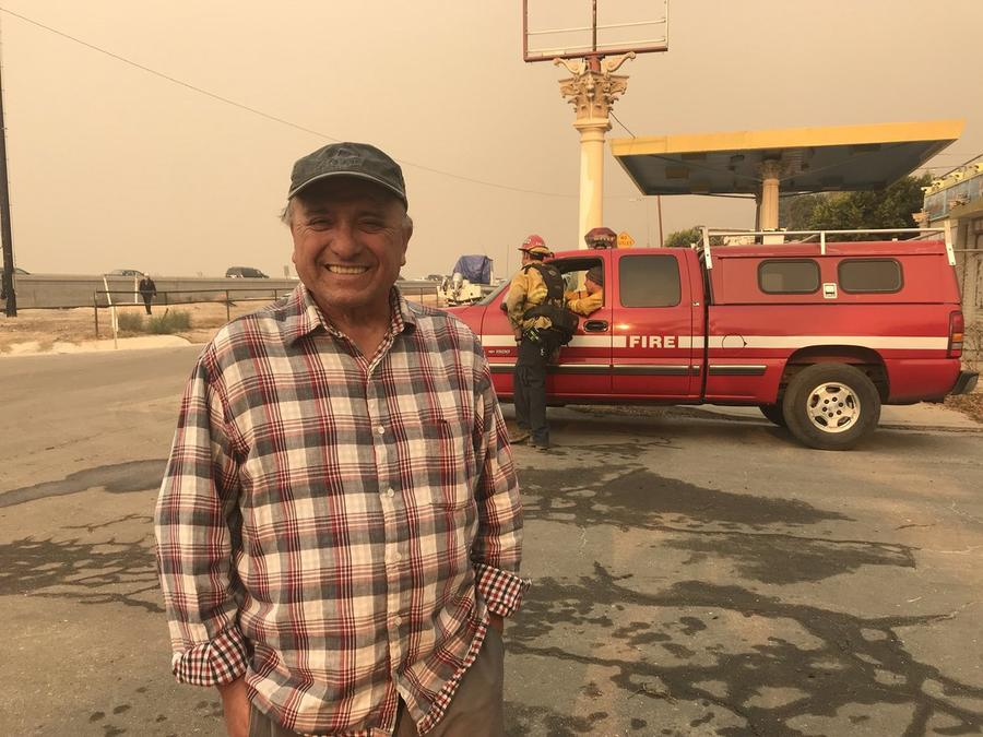 ulio Varela stayed at his home in La Conchita last night and hosed the place down to prevent any embers from setting the house on fire. (Sarah Parvini / Los Angeles Times)