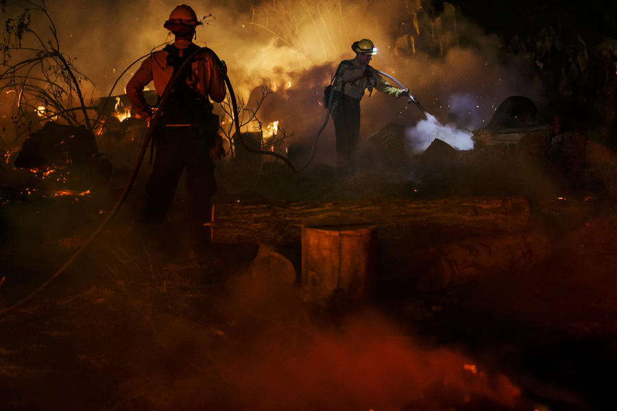 Fire crews work to put out flames on North Rice Road in Ojai. (Marcus Yam / Los Angeles Times)