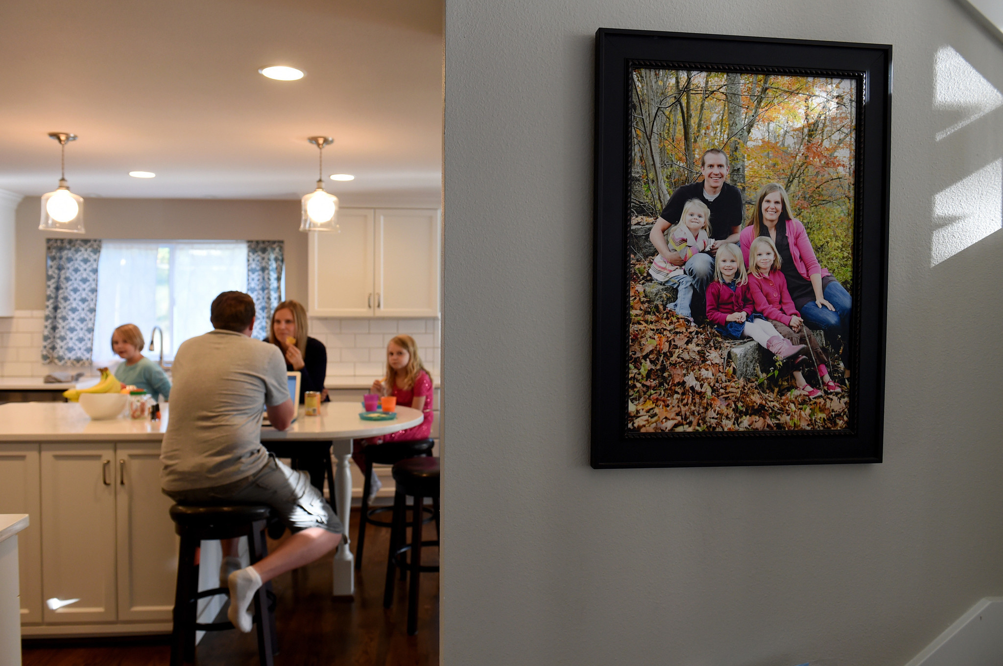 A family portrait hangs on the wall outside the kitchen in the Parker's home in Washington.