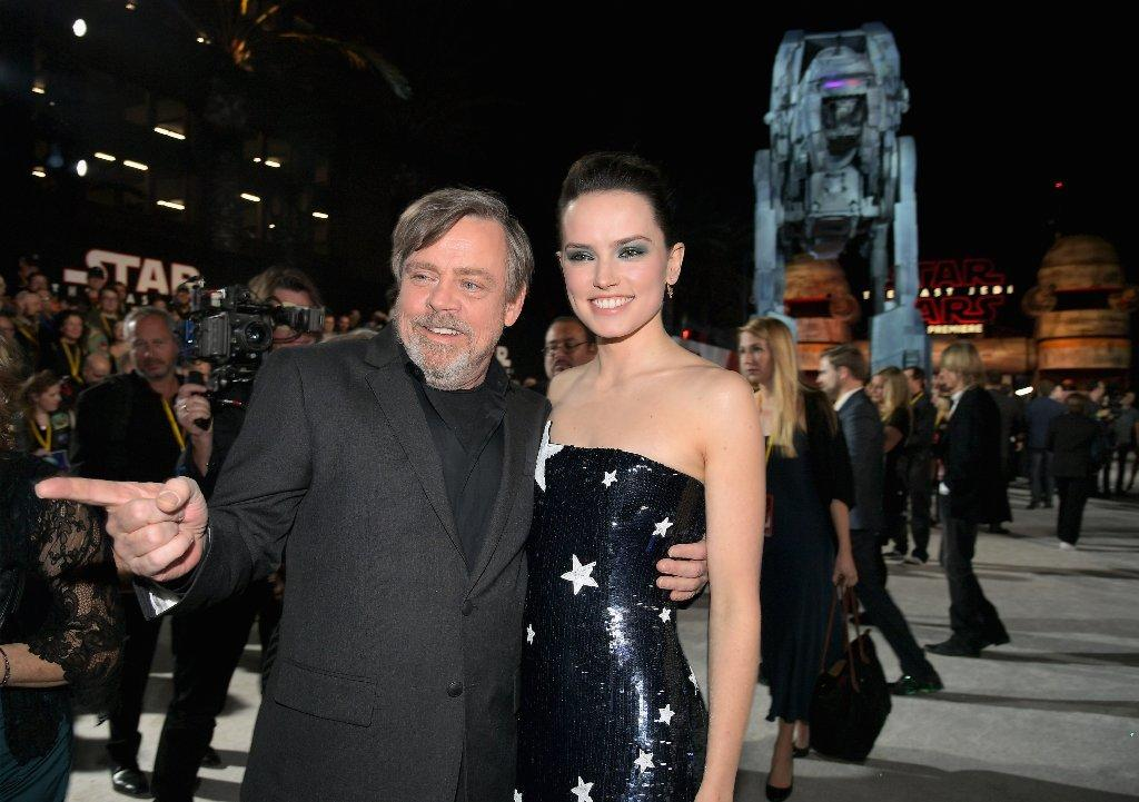 "Mark Hamill and Daisy Ridley step out at the ""Star Wars: The Last Jedi"" premiere at L.A.'s Shrine Auditorium on Saturday. (Charley Gallay / Getty Images)"