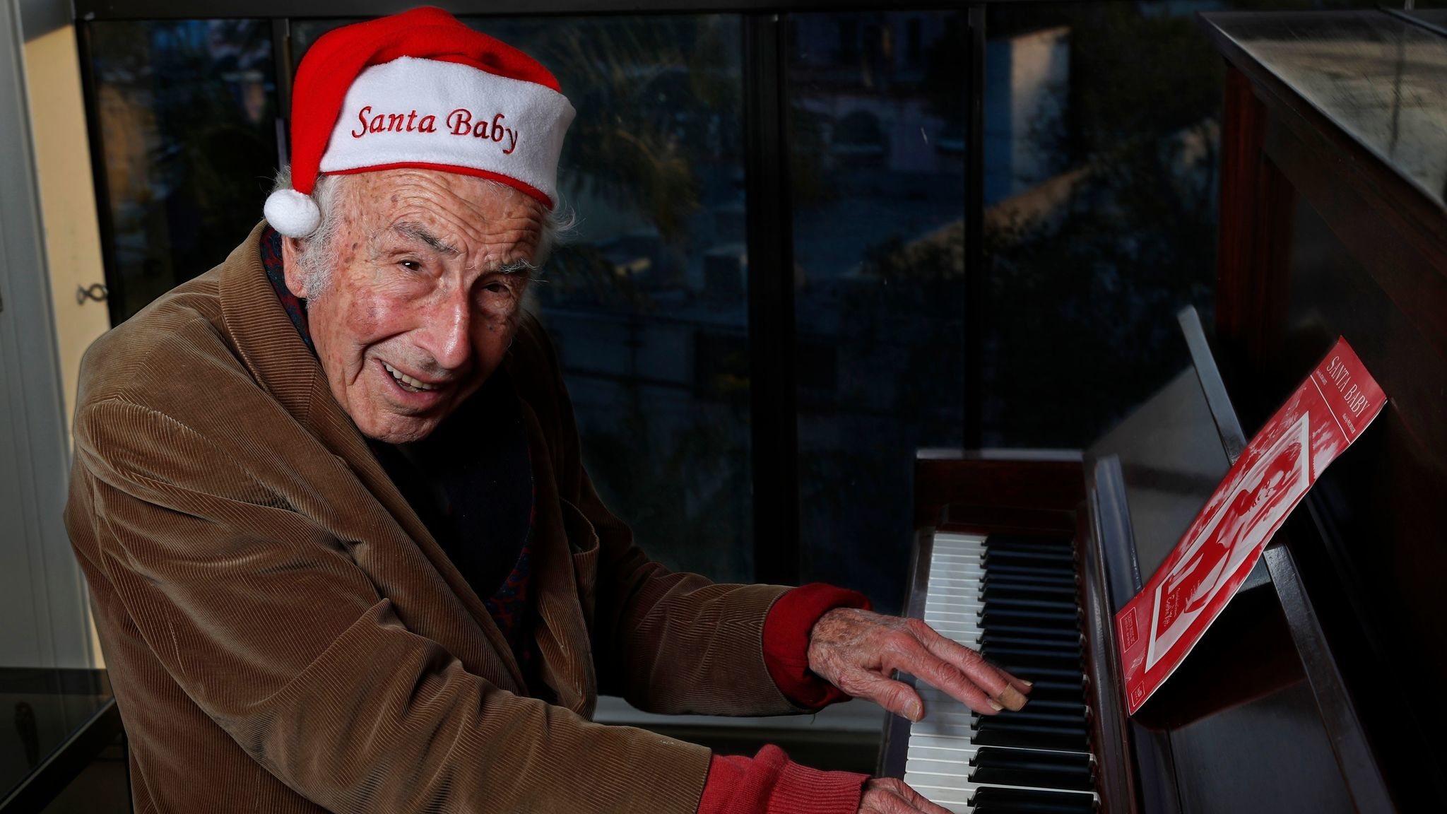"""Songwriter Philip Springer, 91, holds up the original lead line of notes, lyrics, and cord symbols for the song, """"Santa Baby, """" that he co-wrote in August of 1953. Stringer was p"""