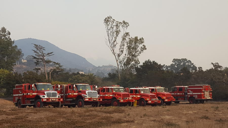 Firefighters set up in an open field in the Montecito evacuation zone. (Joseph Serna / Los Angeles Times)