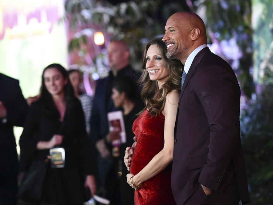 """Dwayne Johnson and Lauren Hashian at the Los Angeles premiere of """"Jumanji: Welcome to the Jungle"""" on Monday. (Jordan Strauss / Invision/Associated Press)"""