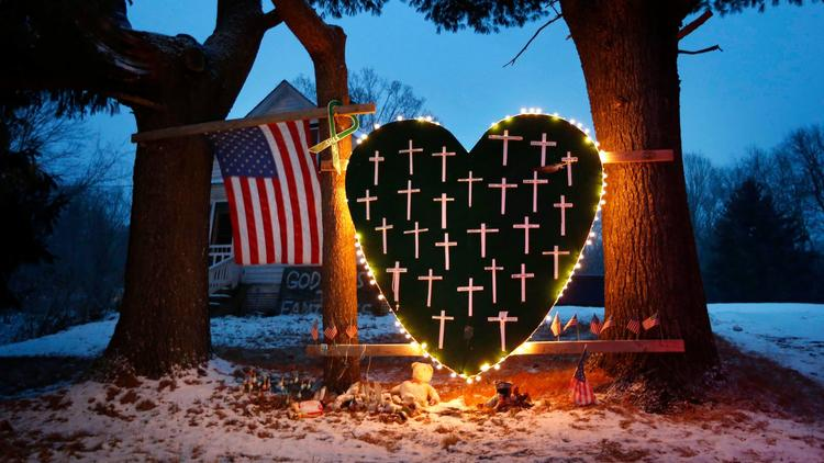 A Sandy Hook memorial is seen on the first anniversary of the shooting. (Robert F. Bukaty / Associated Press)
