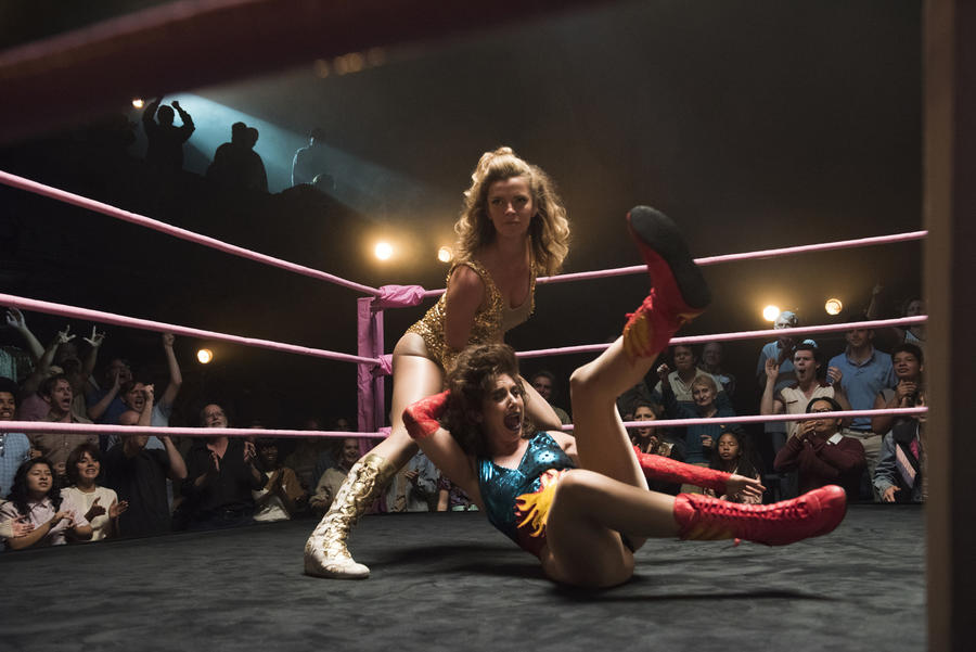 """Betty Gilpin, standing, and Alison Brie in a scene from the Netflix original series """"Glow."""" (Erica Parise / Netflix)"""