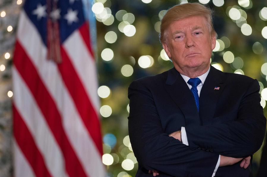 President Trump in the Grand Foyer of the White House on Dec. 13. (Saul Loeb / AFP/Getty Images)