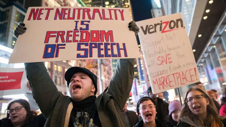 Demonstrators rally in support of net neutrality outside a Verizon store in New York on Dec. 7. (Mary Altaffer / Associated Press)