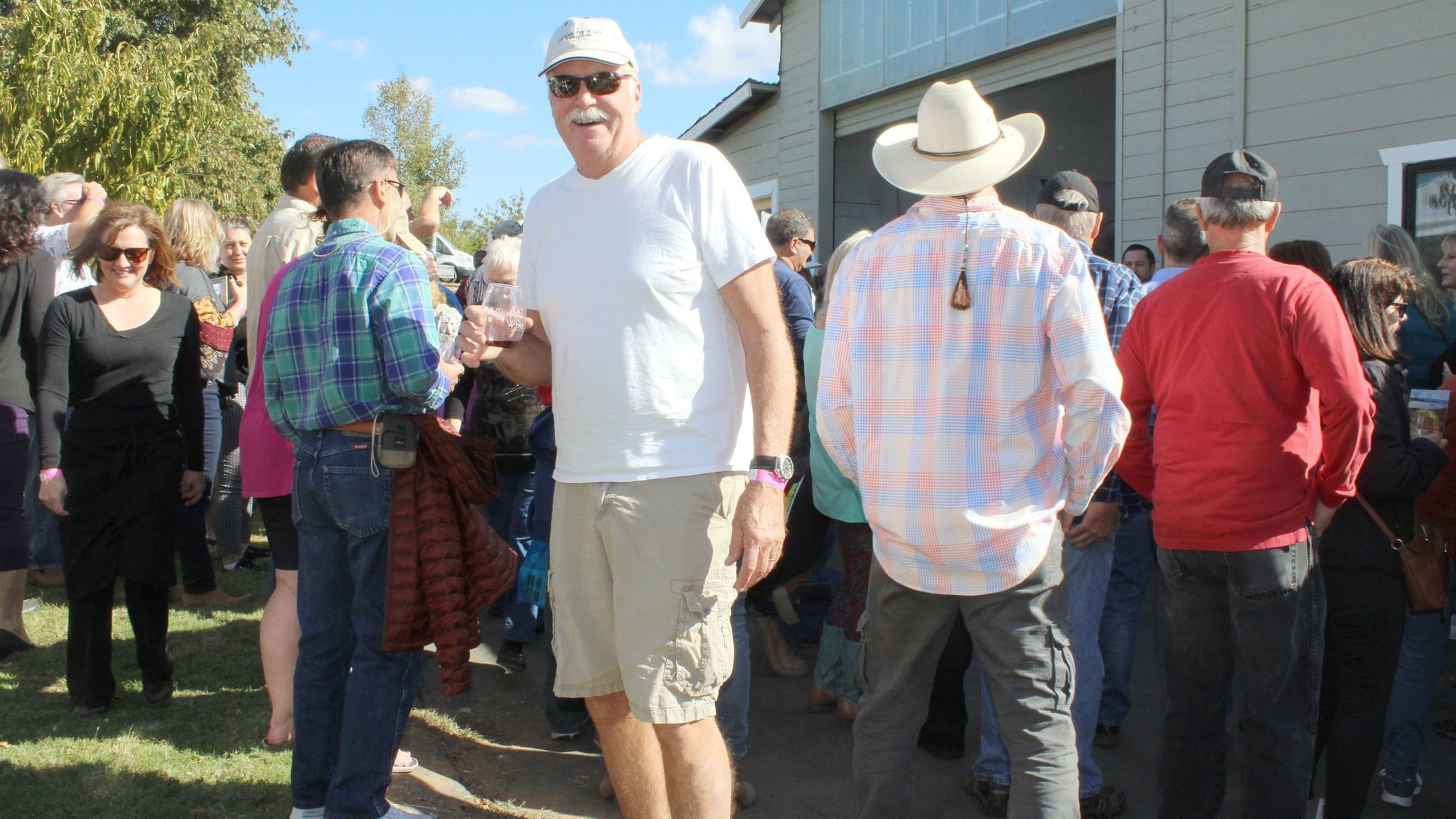 Festival host David Begent talks with guests. He and his wife Molly open their ranch on Highland Valley Road for the festival each year.