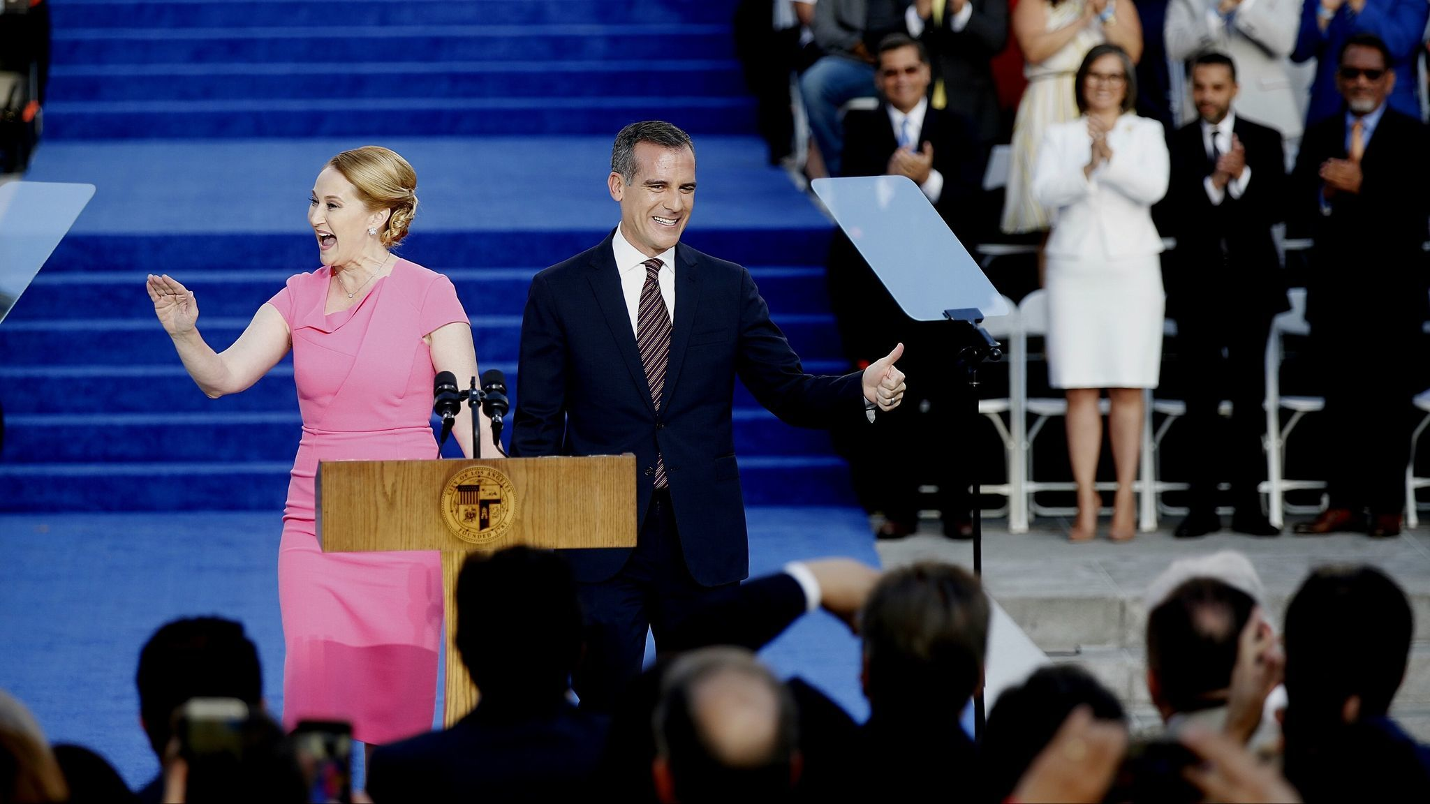 Mayor Eric Garcetti, right, shown with his wife Amy Wakeland, before being sworn in for his second t