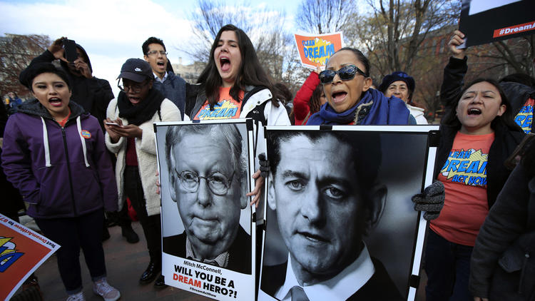 """Amanda Bayer, left with banner, and Marisol Maqueda, right, join a rally in support of so-called """"Dreamers"""" outside the White House. (Manuel Balce Ceneta / Associated Press)"""