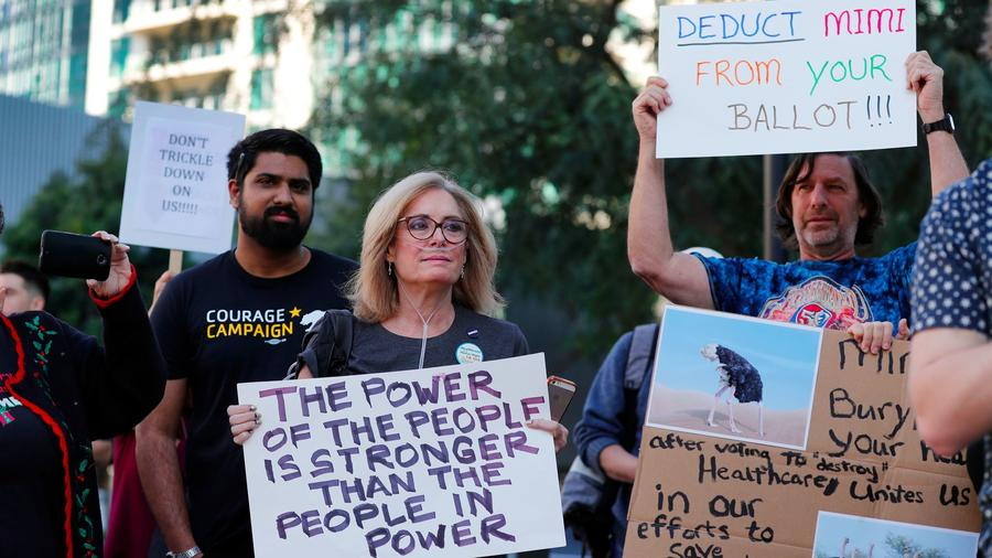 Activists with several California groups rally outside Rep. Mimi Walters' Irvine office. (Allen J. Schaben / Los Angeles Times)