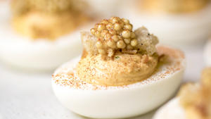 Deviled eggs with croutons and pickled mustard seed