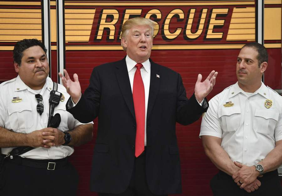 President Trump visits a firehouse in West Palm Beach, Fla., on Wednesday. (Nicholas Kamm / AFP)