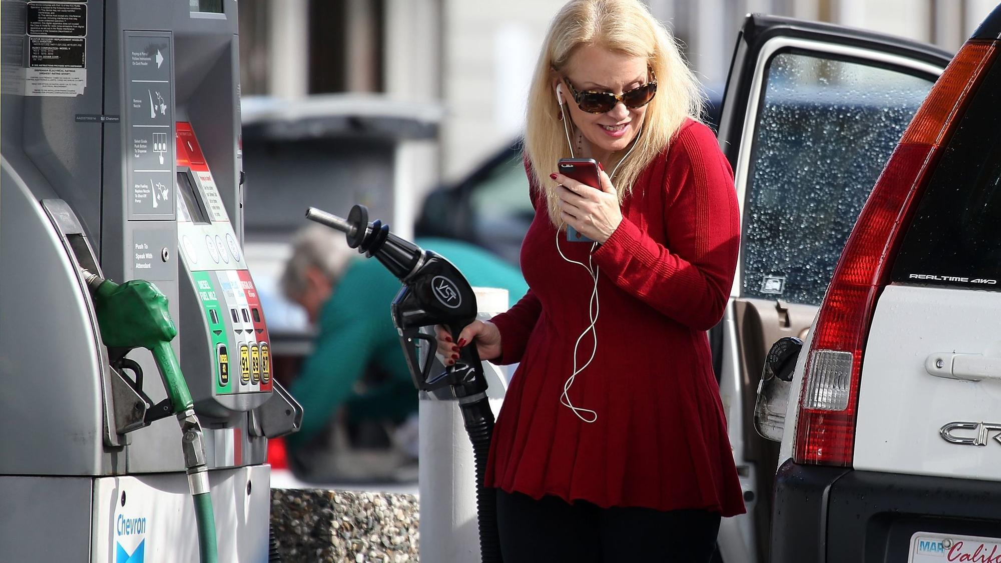 A motorist prepares to gas up her vehicle in San Rafael, Calif., in 2015. (Justin Sullivan / Getty Images)