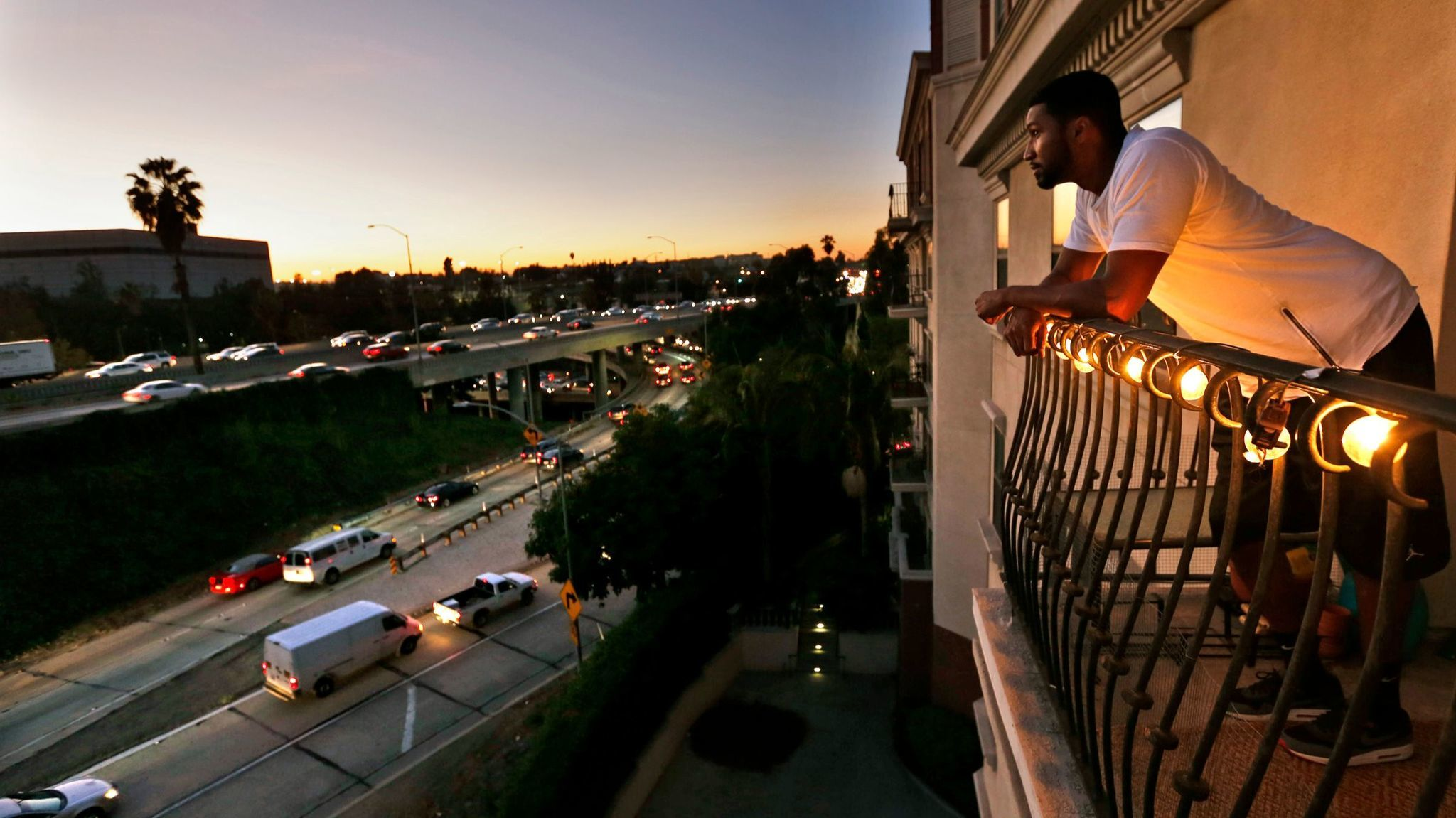 NOVEMBER 18, 2015. LOS ANGELES, CA. Everett Smith, 30, a renter at The Orsini apartments looks out