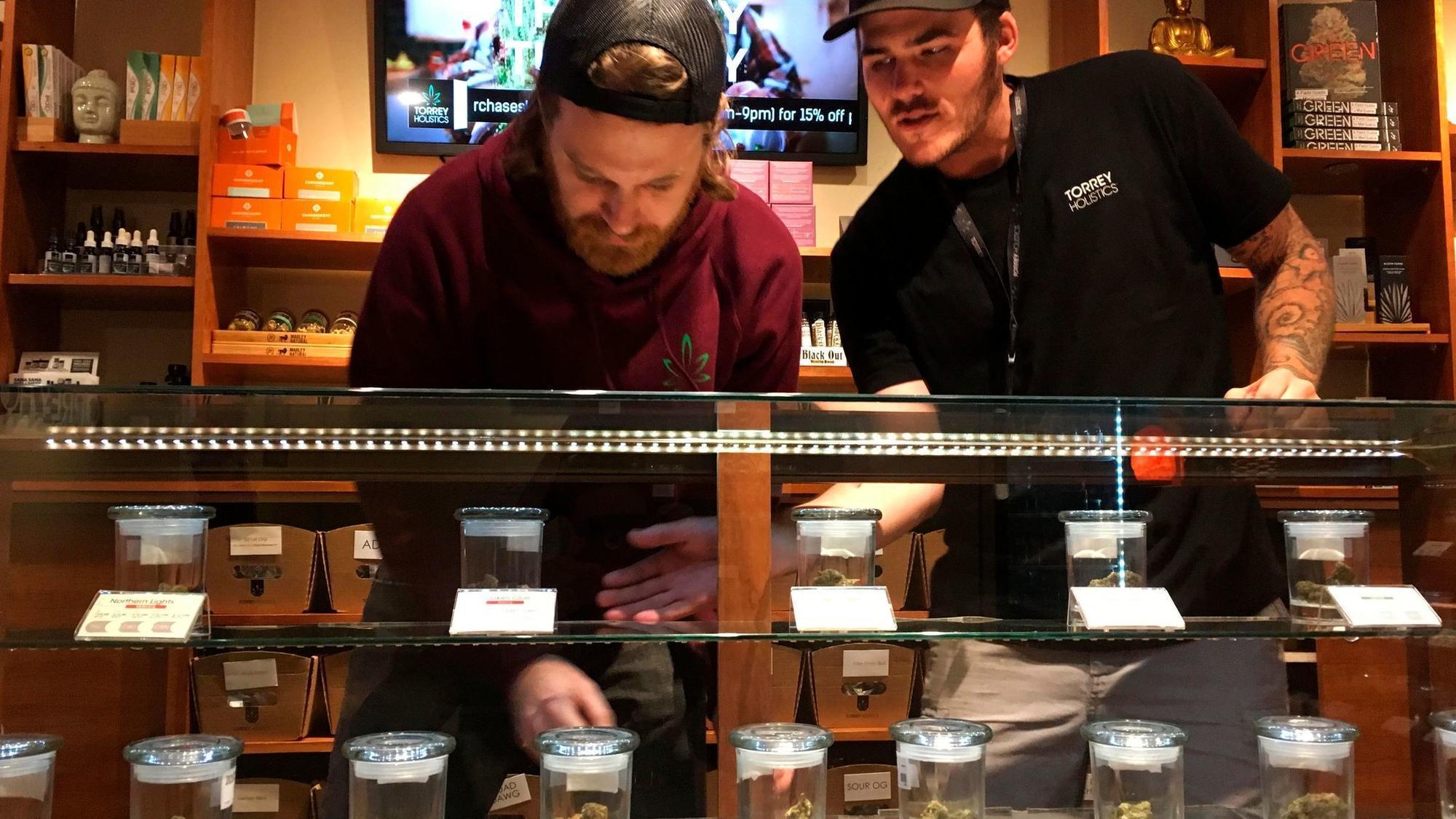 Workers at Torrey Holistics, a San Diego marijuana dispensary. None