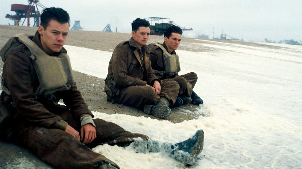 "Harry Styles, from left, Aneurin Barnard and Fionn Whitehead in a scene from ""Dunkirk."""