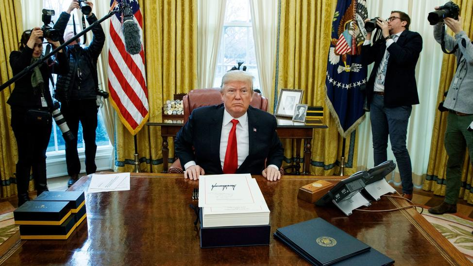President Donald J. Trump in the Oval Office after signing the tax bill on December 22nd, 2017. — Photograph: Evan Vucci/Associated Press.
