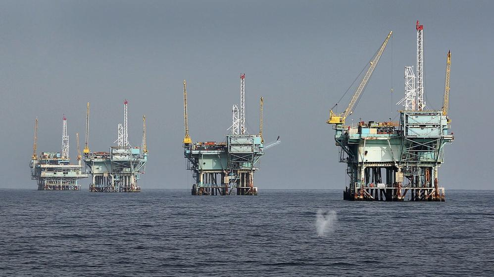 Oil companies may have trouble justifying the cost of new offshore developments at a time when hydraulic fracturing on land is cheaper. Above, oil rigs in the Santa Barbara Channel in March 2015. — Photograph: Al Seib/Los Angeles Times.
