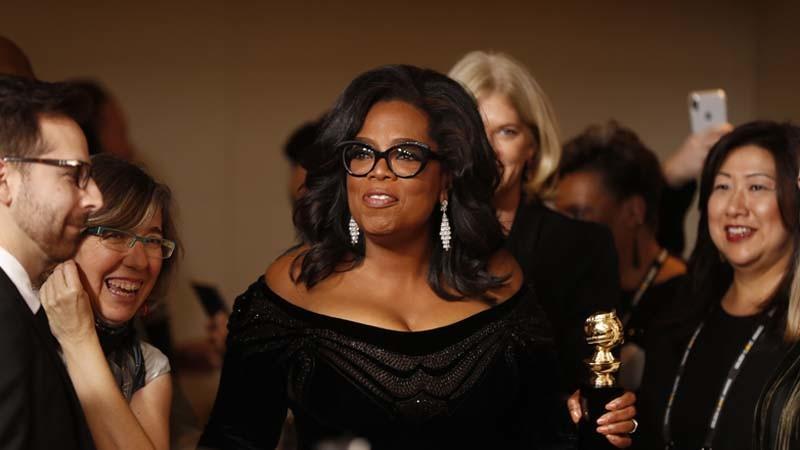 Oprah Winfrey with her Cecil B. DeMille Award backstage at the Golden Globes. (Allen J. Schaben / Los Angeles Times)