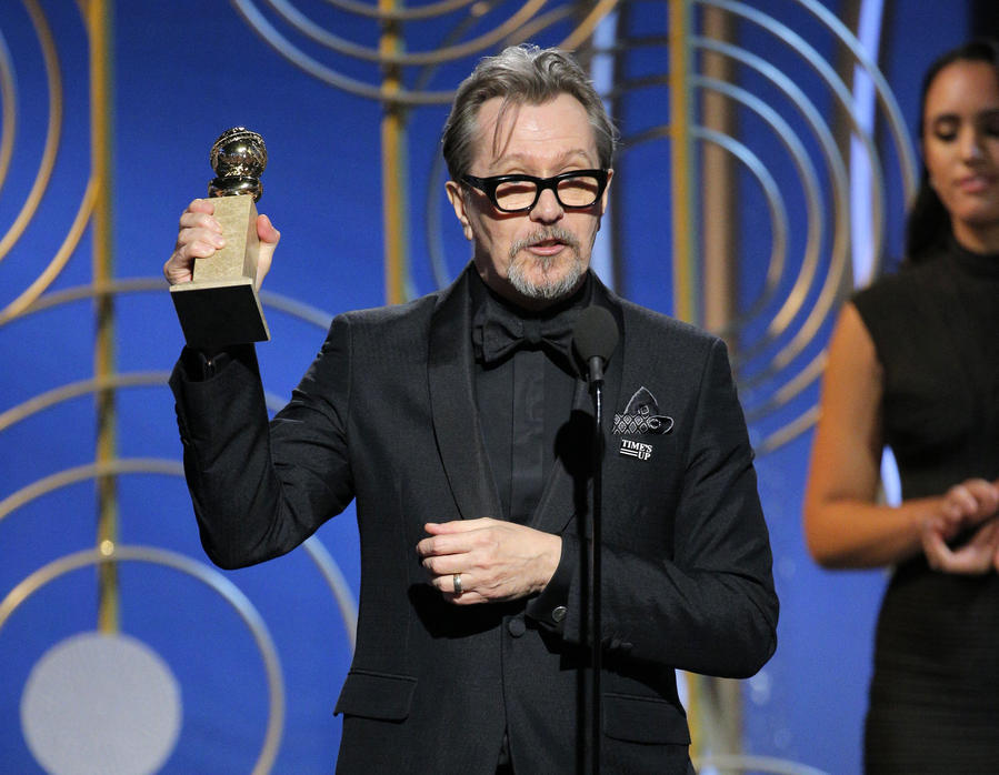 "Gary Oldman accepting the award for best actor in a motion picture drama for his role in ""The Darkest Hour,"" at the 75th Annual Golden Globe Awards. (Paul Drinkwater / NBC via AP)"
