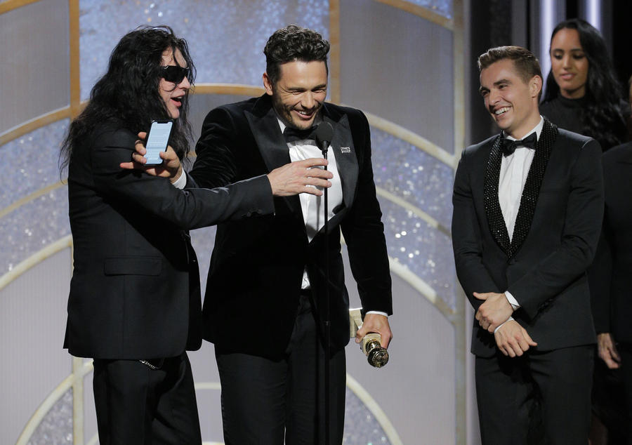 Tommy Wiseau, James Franco and Dave Franco on stage at the Golden Globe Awards ceremony on Jan. 7.. (Paul Drinkwater / NBC)