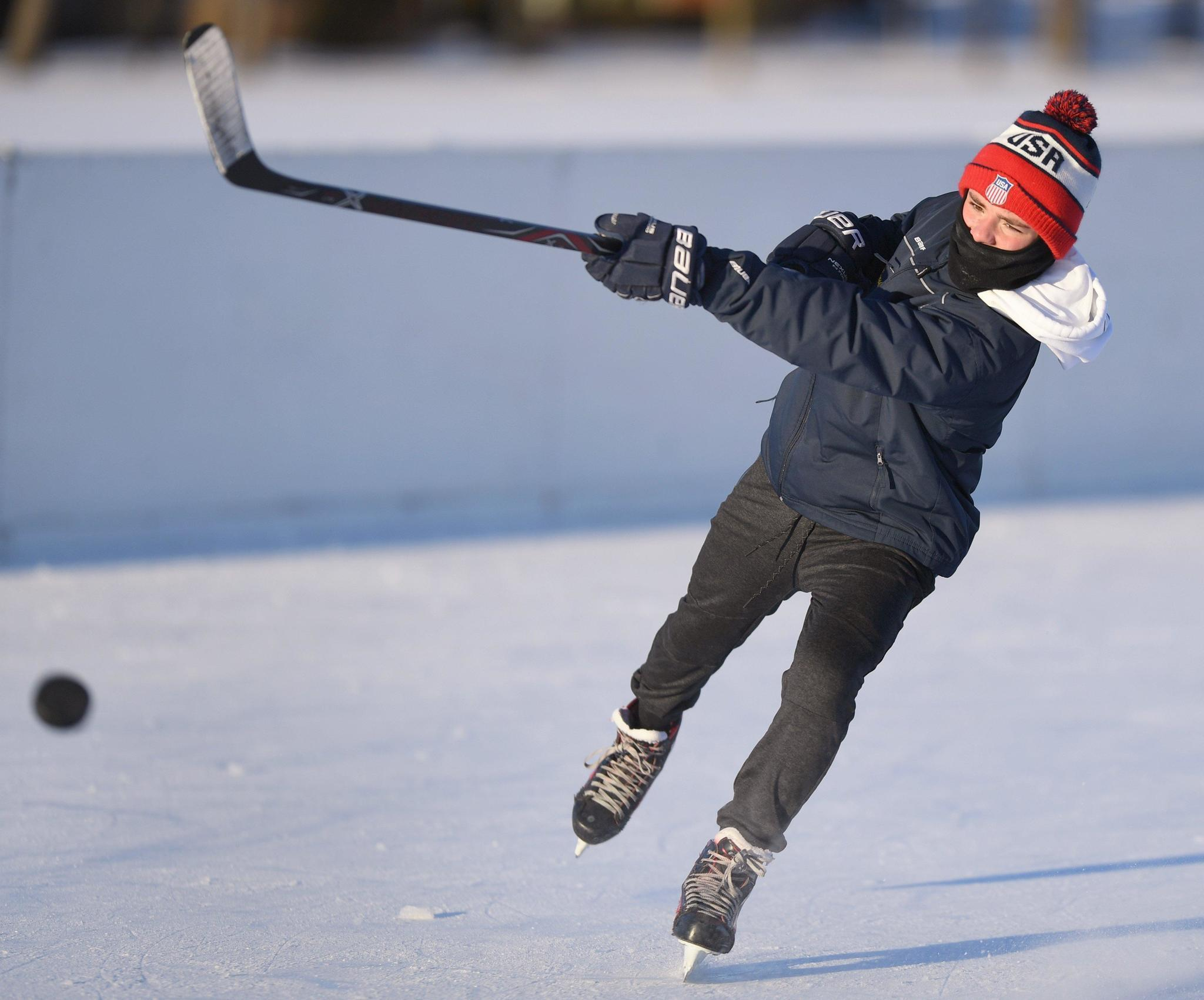 Cold temperatures provide a boon for suburban outdoor ice rinks