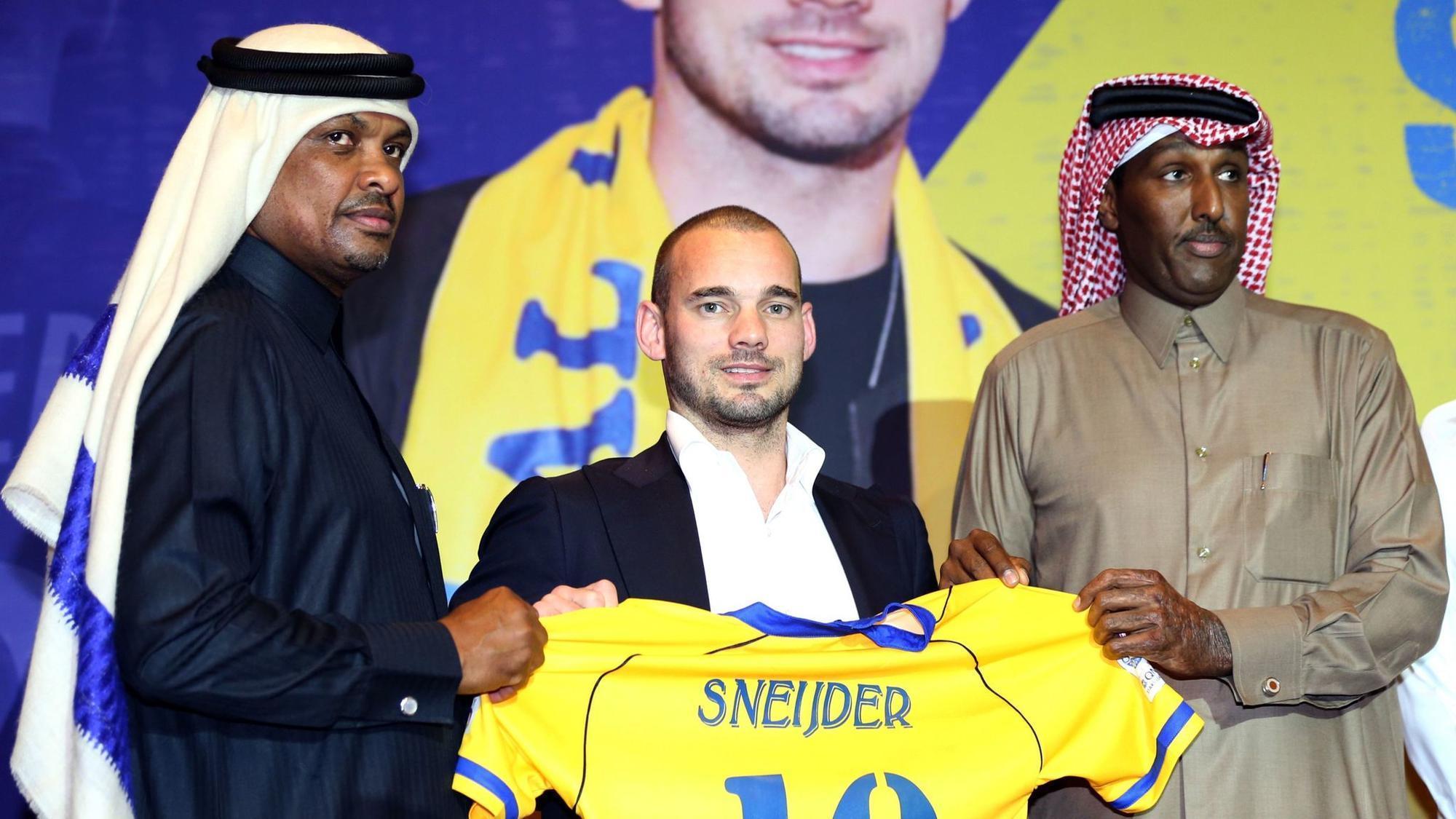 Risultati immagini per sneijder al gharafa
