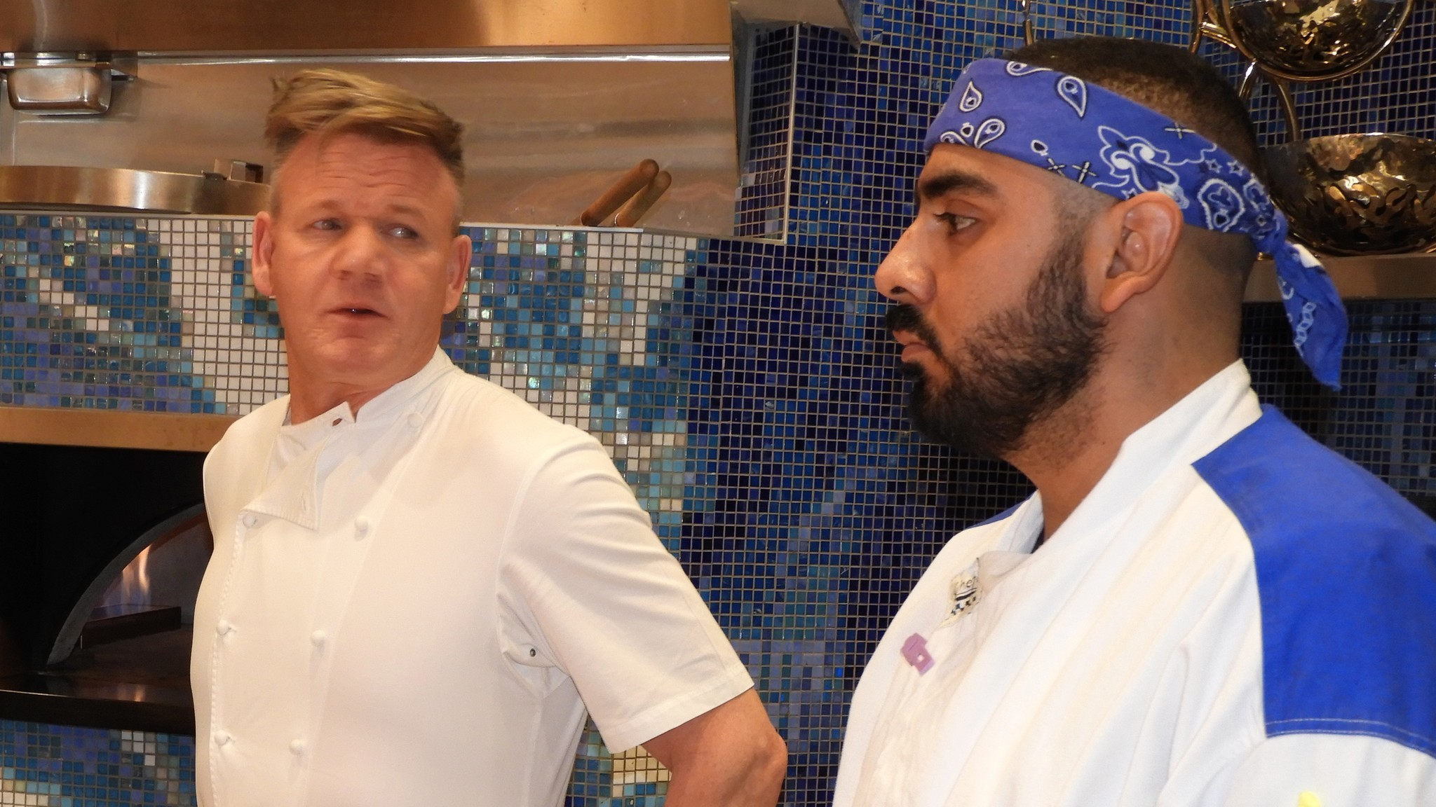 at lunchtime sunday celebrity chef gordon ramsay left discusses the food service with one of the cooks at his new hells kitchen restaurant jay jones - Hells Kitchen Las Vegas 2