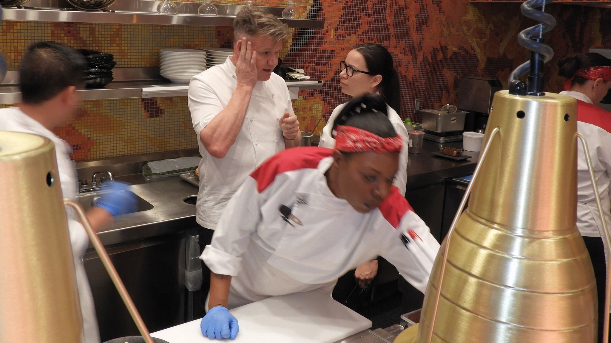 as cooks hurry about their assigned tasks chefs gordon ramsay and christina wilson confer at hells kitchen in las vegas wilson a top executive in - Hells Kitchen Las Vegas 2