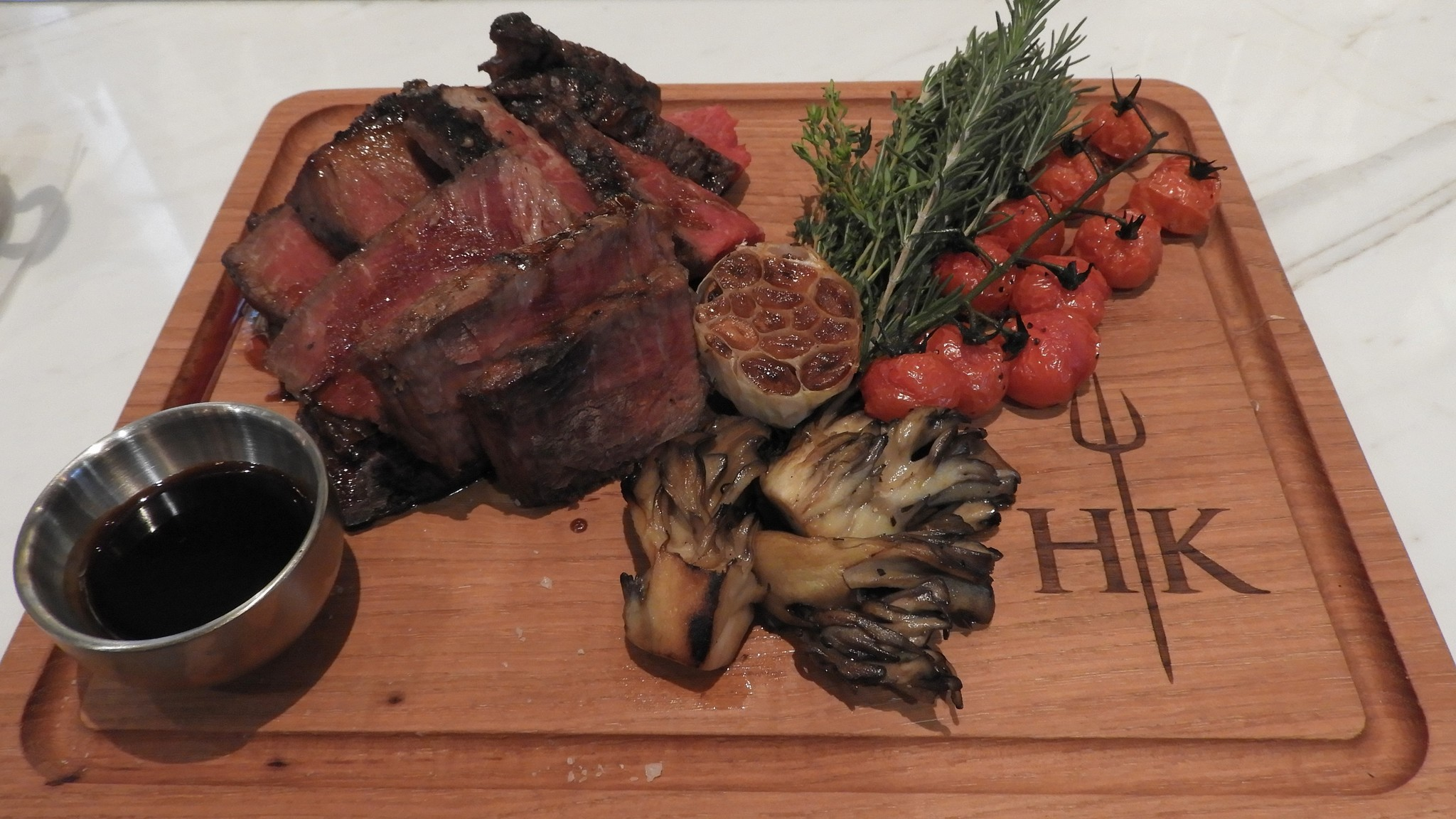 hells kitchen a porterhouse steak aged for 30 days is prepared for parties of two with barnaise sauce and two sides it is priced at 125 jay jones - Hells Kitchen Vegas