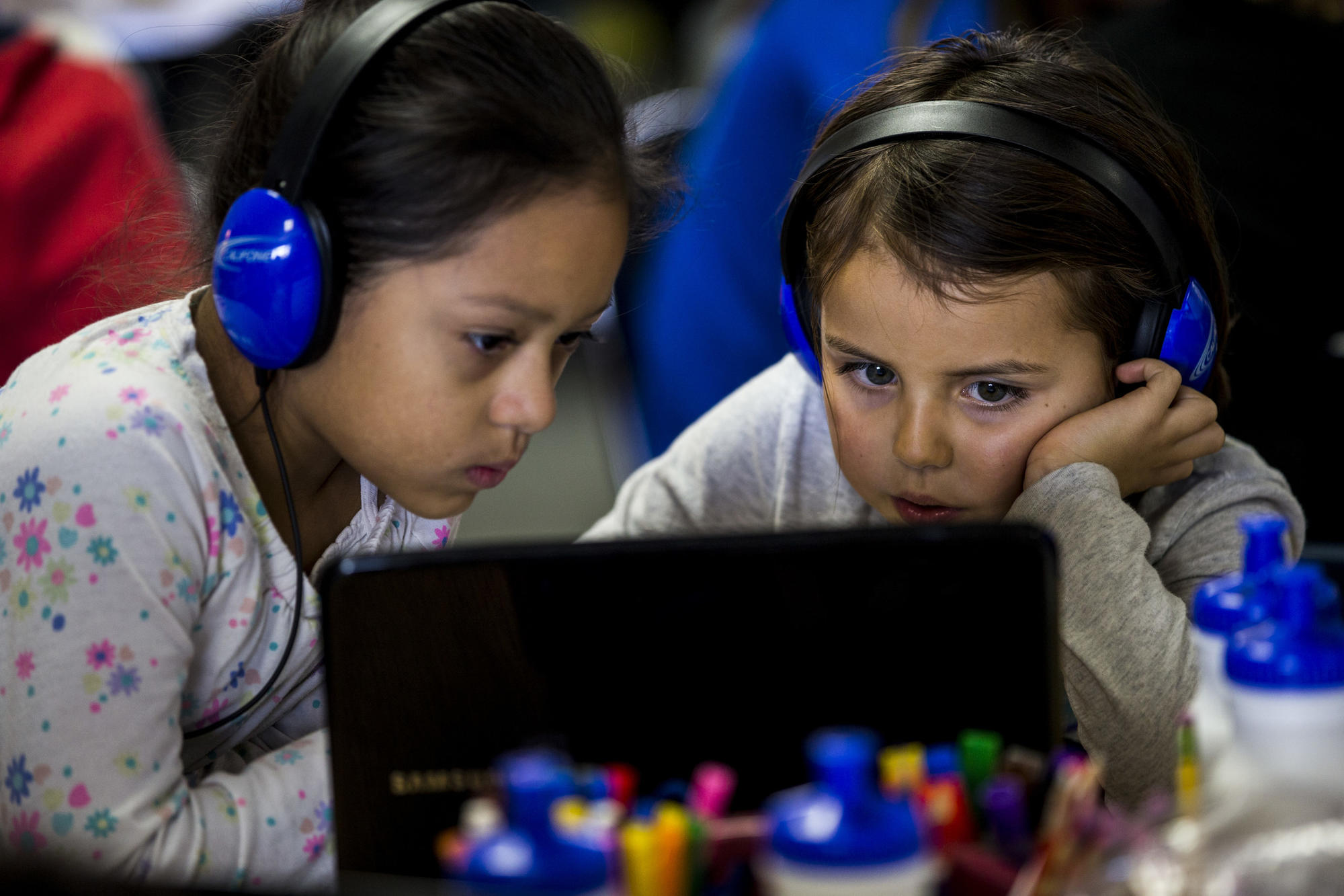 Esperanza Hernandez, left, and Teagan Garcia use Chromebooks in Joanie Bryant's class at Waggoner Elementary School in Winters. (Kent Nishimura / Los Angeles Times)