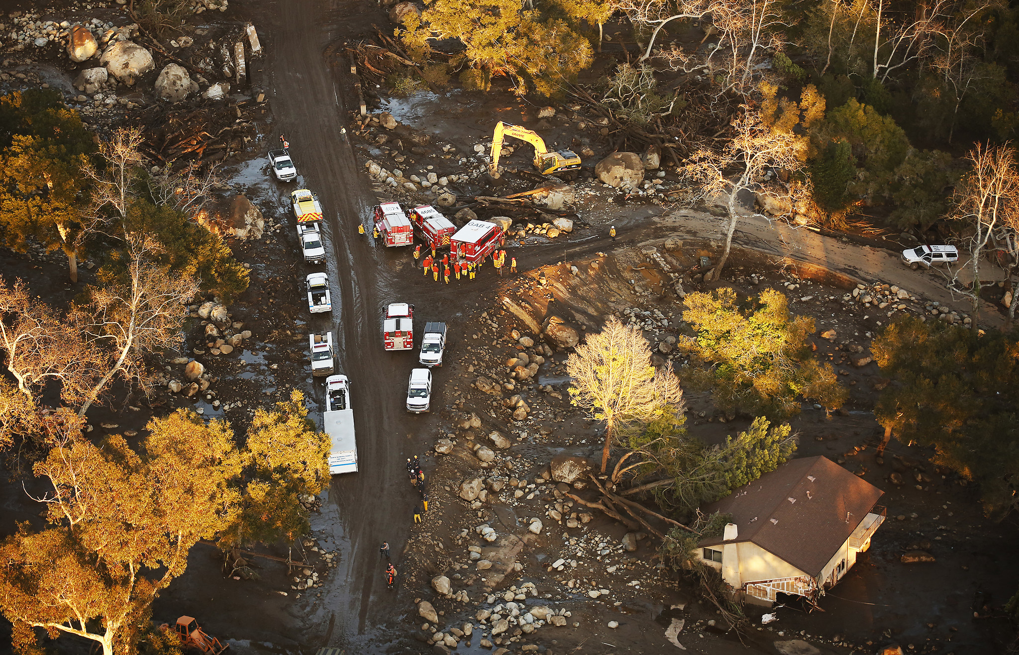 MONTECITO, CA – JANUARY 10, 2018: Crews work in the Romero Canyon area surrounded by mud and debr
