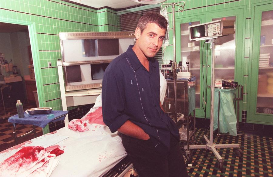 """Actor George Clooney on the set of """"ER"""" in 1996. The long-running NBC series is now available to stream on Hulu. (Kirk McCoy)"""