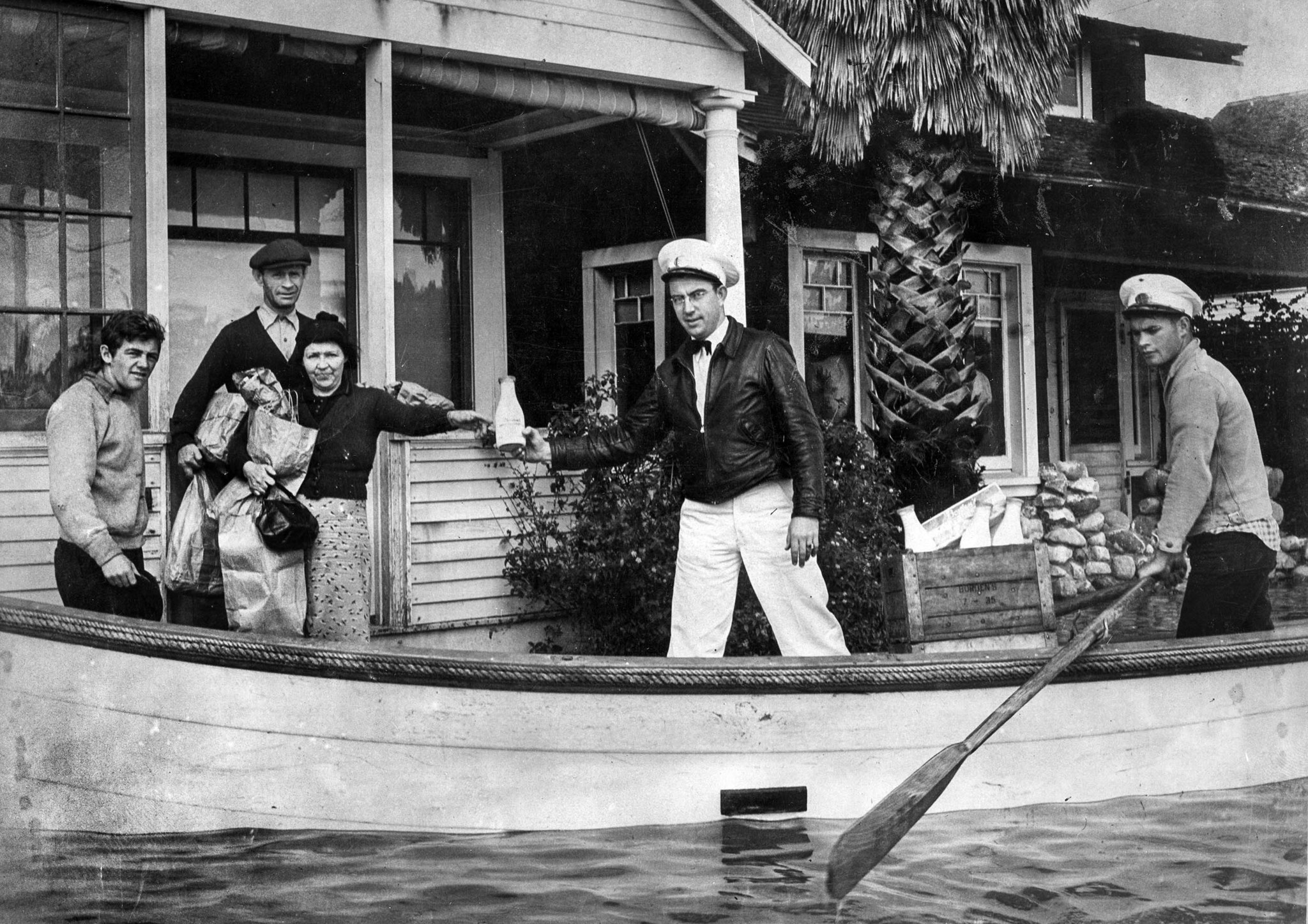 March 3, 1938: Milkman Ray J. Henville secured himself a boat and boatman and made all deliveries on