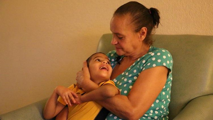 Maria Baez Claudio, 53, benefits from the federal Transitional Shelter Assistance program, but worries about long term housing options for her and her 5-year-old grandson.