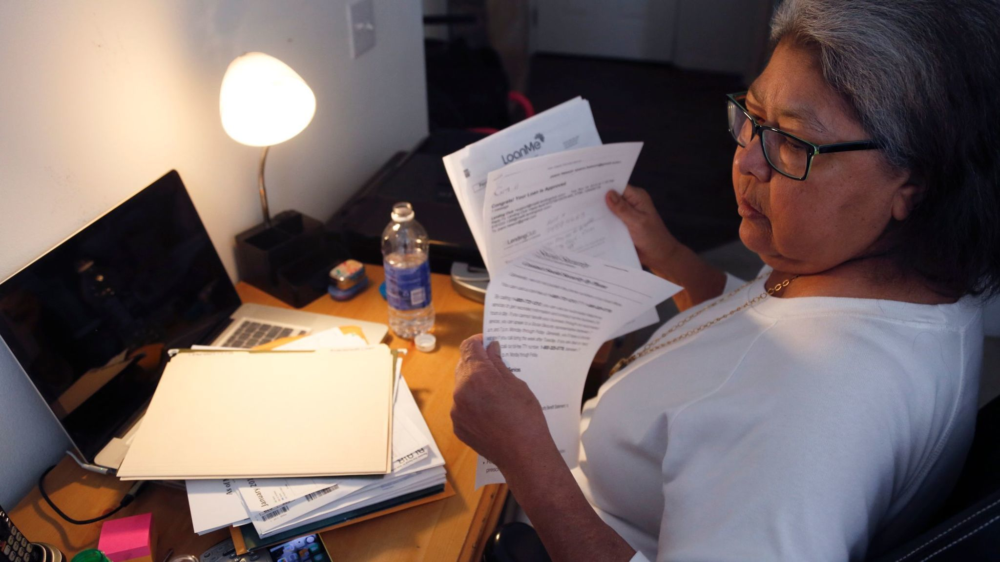 RANCHO SANTA MARGARITA , CA., JANUARY 22, 2016: Joann Hesson, 67, sifts through the paperwork of h