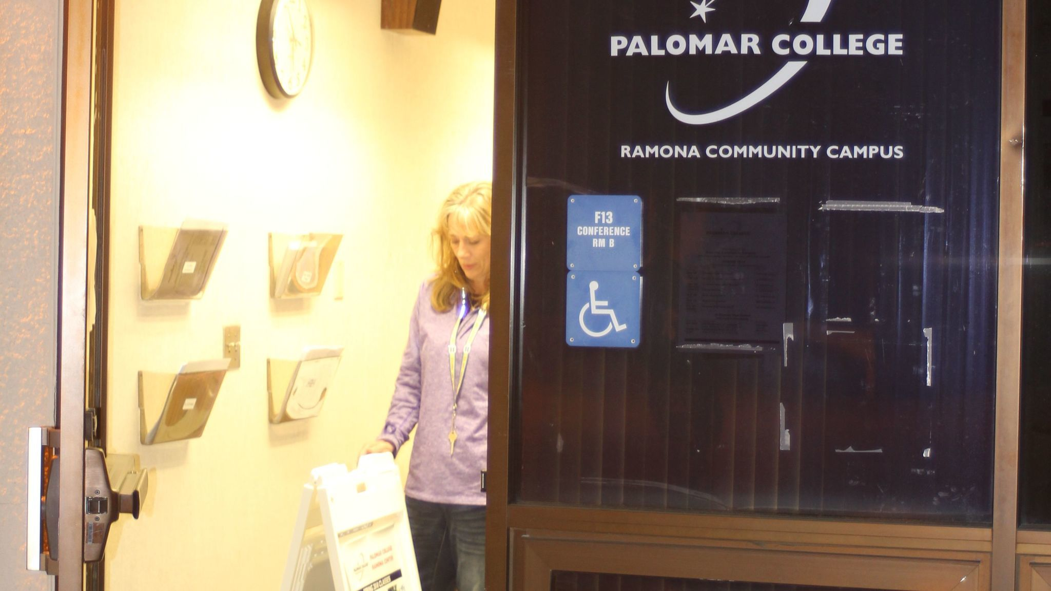 Leighanne Kirchner, the office manager for Palomar College on the Ramona Community Campus, works on advertising the schedule for current and future Palomar classes.