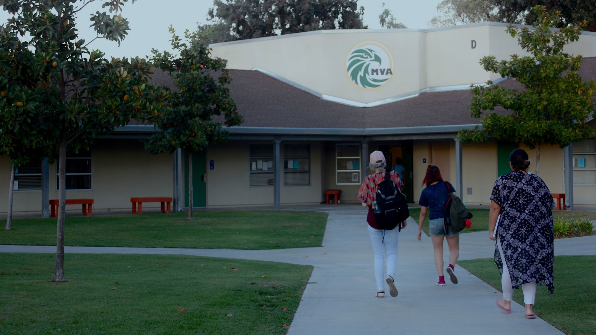 Three Ramonans - two high school students and one adult - walk to their evening college class on the Ramona Community Campus.