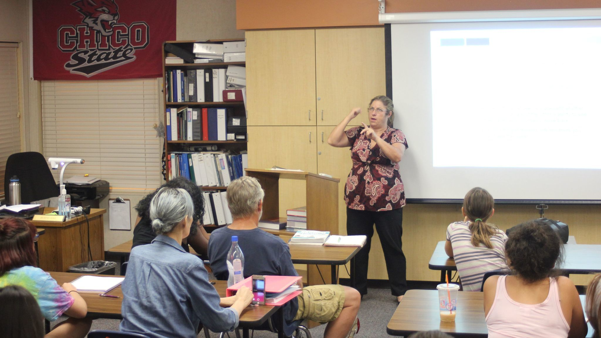 Palomar American Sign Language 100 Professor Karen Boyle signs instructions to her students ages 11 to 56.