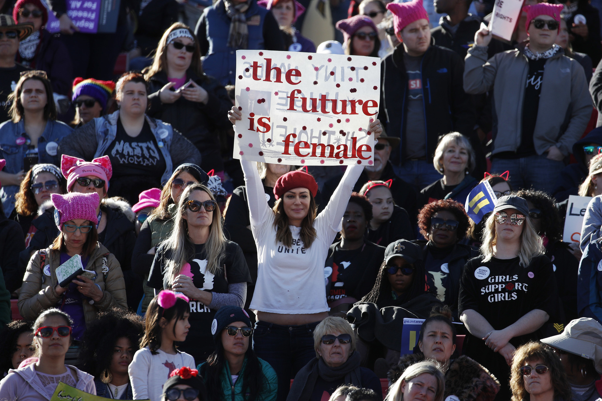 Around the world — and near Trump's home — women march in show of political force