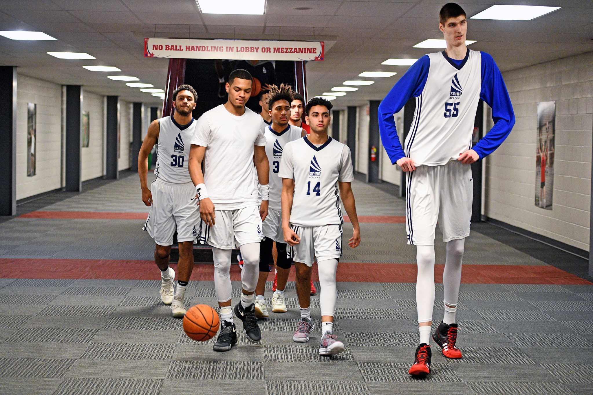 8b2adaac6a73 7-foot-7 high school basketball player a star attraction despite rarely  playing